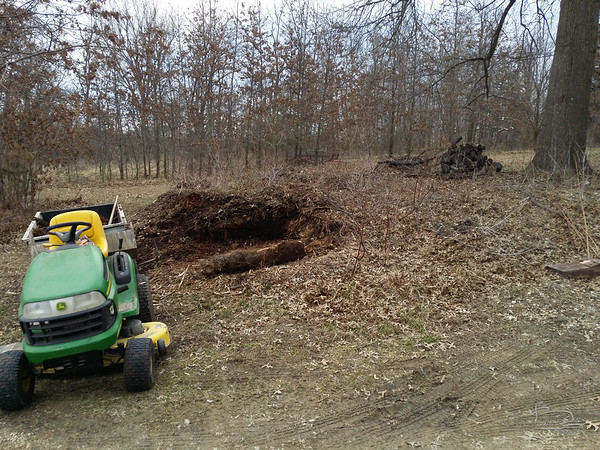 Wood chip pile slowing shrinking.