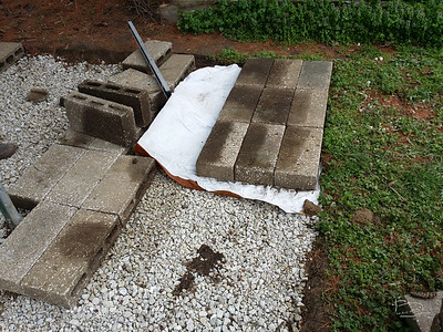 Simple installation plan for stones.  I think maybe the paper should have gone under the gravel.  The paper is that stuff they used when shipping bare root seedlings from the nursery.