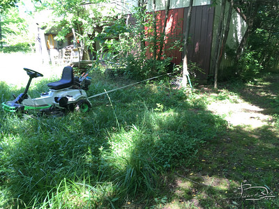 This battery powered mower can pull really heavy loads, even with low traction lawn tires.  I like to use this two inch wide strapping that is used to bundle skids of lumber.  Being flat and wide makes it easy to untie the knots after pulling.