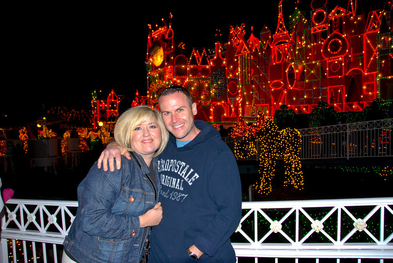 Our great friends Charlie and Jamie outside It's a Small World at Disneyland, December 2010.