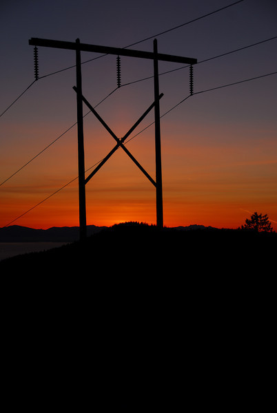 Sunset near Cypress Mountain Ski Resort in Vancouver, British Columbia.  I purposely took this photo with the electrical tower in it because it adds to the shot IMHO.