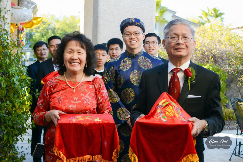 From a traditional Vietnamese wedding - the Groom and his family receiving the Bride and arriving at her house bearing gifts covered in red cloths.