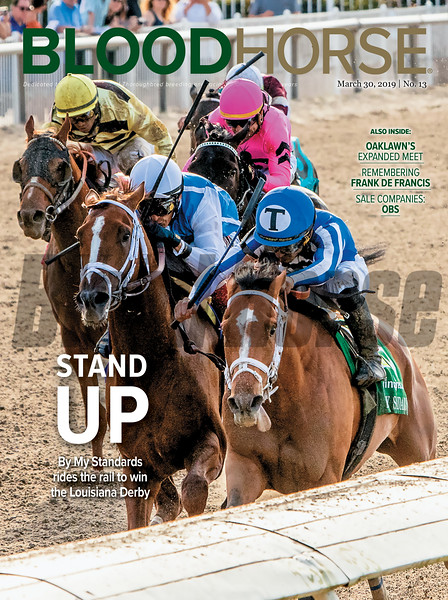 March 30; 2019; issue 13; cover of Blood Horse; Stand Up: By My Standards rides the rail to win the Louisiana Derby; Also Inside: Oaklawn's Expanded Meet, Remembering Frank De Francis, Sale Companies OBS; On the cover: By My Standards and Gabriel Saez capture the Louisiana Derby (G2) at Fair Grounds Race Course & Slots.