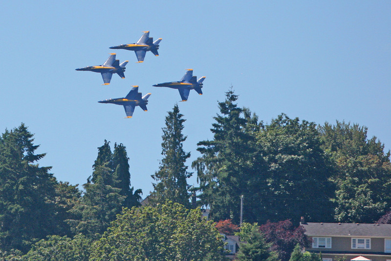 The Blue Angels fly low over homes overlooking Lake Washington