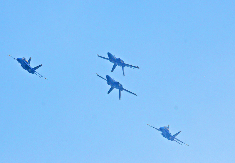 The Blue Angels fly two up and two inverted in a close pattern over Lake Washington