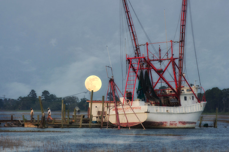 The Backman Enterprise under a rising full moon