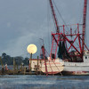 The Backman Enterprise under a rising full moon