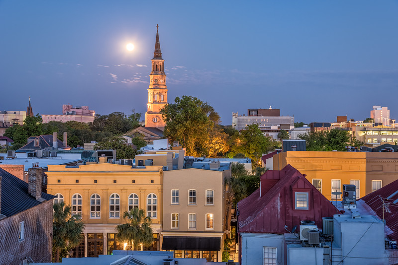 St. Philips Church steeple and moon setting over Charleston rooftops