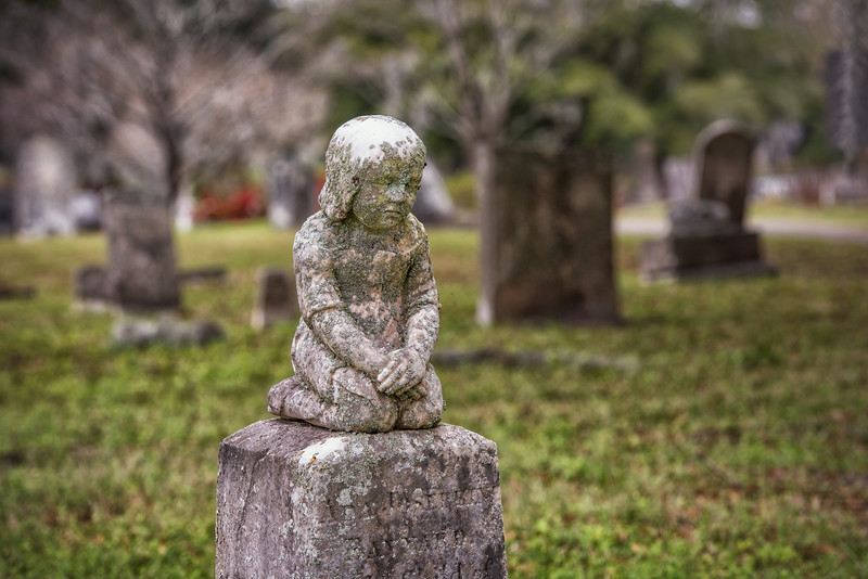 Sad little stone girl, Magnolia Cemetery