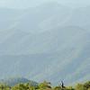 Artist painting mountain scene