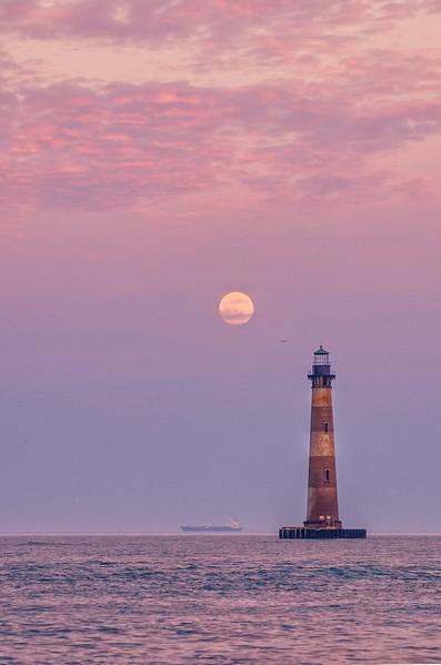 Full moon rises over Morris Island Lighthouse
