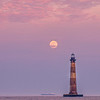 Full moon rises over Morris Island Lighthouse