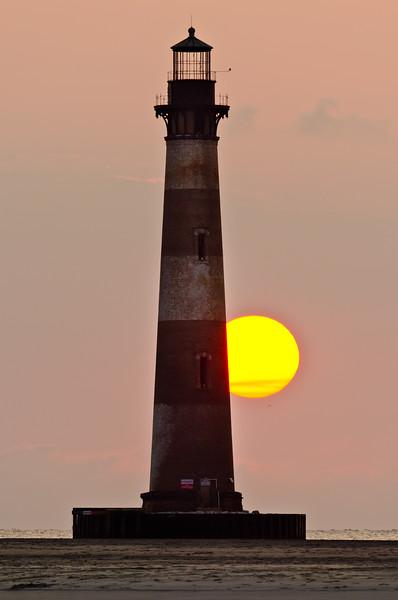 Sunrise over Morris Island lighthouse