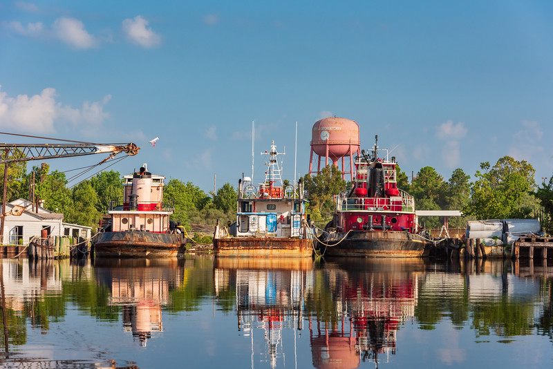 Tugboats tied up in the Sampit River near Highway 17