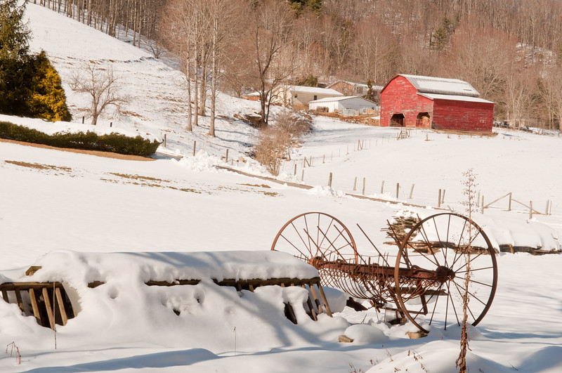 Red Barn and farm equipment in the snow, NC