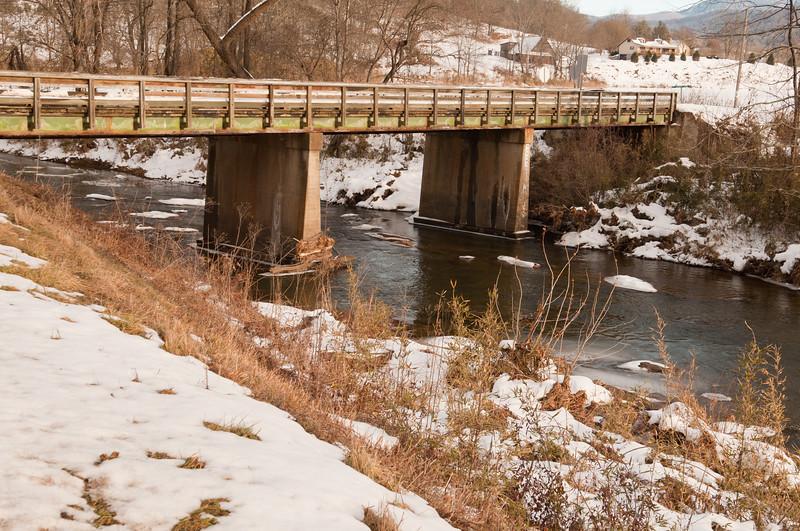 Bridge over river in the snow