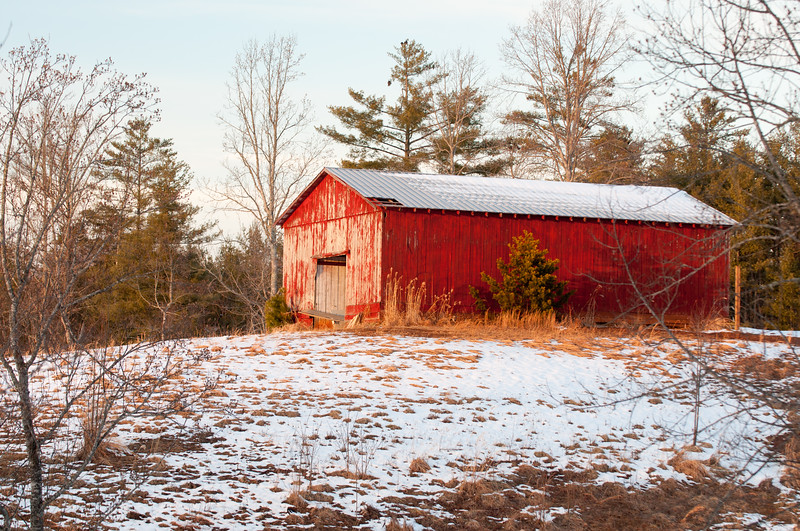 Red barn and sprinkling of snow in North Carolina