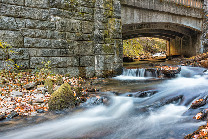 Stream and cascades under old stone bridge on N.C.276