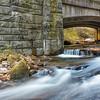 Stream and cascades under old stone bridge on N.C.276