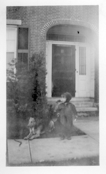 John Lacey with family dog Figi at family home in Southbridge MA. One of several successive dogs in the family, including a sheep dog.