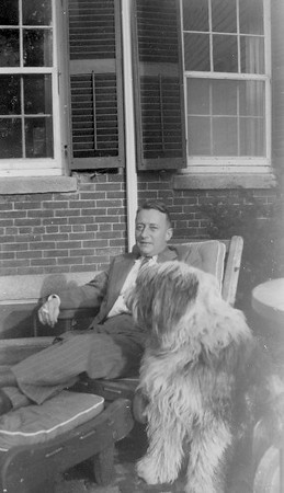 James T. Lacey MD with dog Blue on patio at Family home in Southbridge MA. Jim Lacey III did the brickwork for the patio.