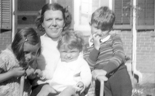 Charlotte Lacey with children, L -> R, Joan, John and Jim on patio at family home in Southbridge MA.