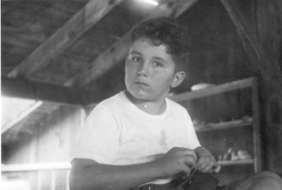 James T. Lacey III in Camp Robinson Crusoe workshop. Circa 1945
