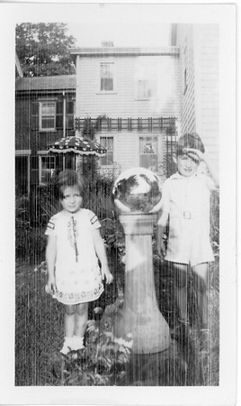 Joan and Jimmy Lacey in yard at Southbridge MA family home