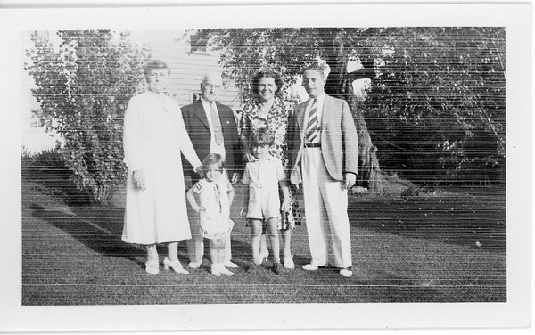 L -> R (Rear) Mrs. (Martha) and Mr. James T. Lacey Sr with their Son Dr. James T. Lacey Jr. and daughter-in-law Charlotte VanCleve Lacey<br /> L -> R (Front) Joan Lacey and James T Lacey III<br /> The elder Laceys from Madison, WI were visiting the Lacey Family home in Southbridge MA.