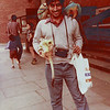 Asjad in London at  the General Post Office, at that time one of the tallest buildings in the city.  Some Professional photographer whose pets those were offered to take this photograph.  On his shoulder and hand are two monkeys and a macaw on the other shoulder.