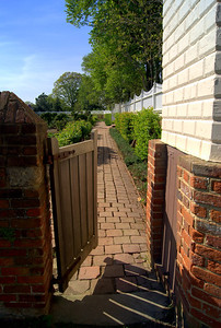 The property consists of 500 acres, with the main buildings, including the house, located close to the river front.  To each side of the green is a garden, contained by a red brick wall. These gardens grew the household's vegetables, fruit and other perishable items for consumption.