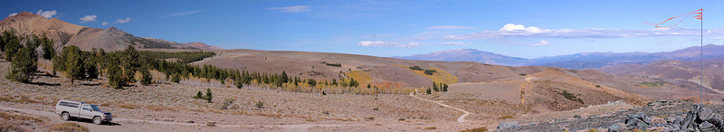 """And this is a panorama taken from the same spot as Mono Lake, only this time looking north. It shows the road around Copper Mountain, the Sweetwaters on the horizon -- and a wind flag. Though this version is compressed, panos are the only true way to get the """"you are there"""" feeling for the landscape."""
