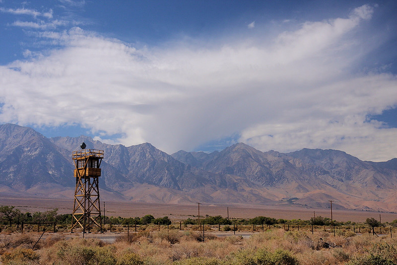 "Here's a photo of the ""Sierra Wall"" with a wind current-sculpted cloud. This is the site of Manzanar, the Japanese ""internment"" camp for the western US during WWII, located just north of Lone Pine.  The guard tower is a facsimile, but I thought it made an interesting image in this setting."