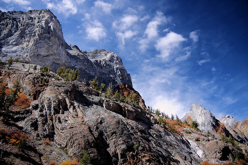 The rocks in this section of the eastern Sierra have bizarre and colorful patterns, showing the geologic struggle that formed them. And the autumnal colors add to the rugged beauty of the landscape.
