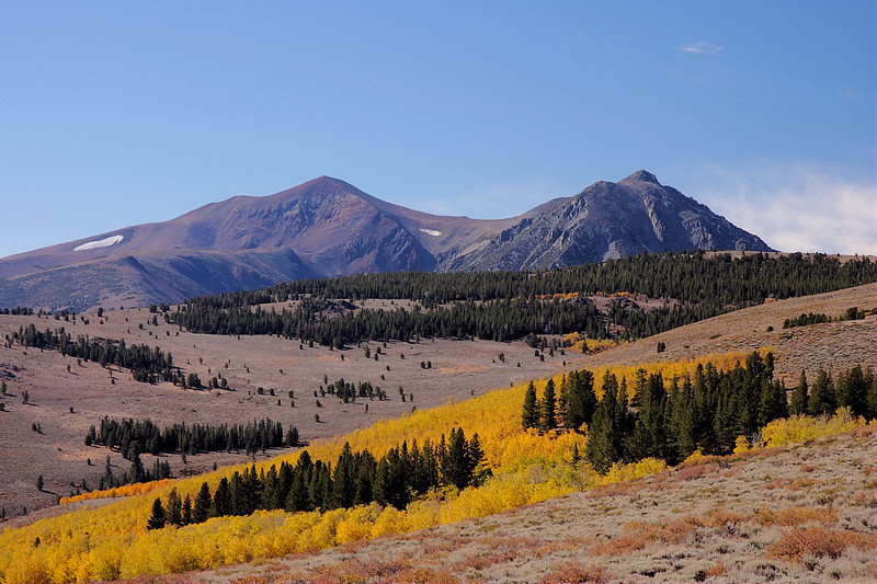 The views from the 4-wheel-drive road around Copper Mountain are expansive from the start. This is looking southwest towards Mt. Warren, with the burnt orange of autumn creating a contrast with the earth tones of rock,scrub and pine.