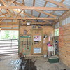 Facing feed/tack room; my back is to Glenn's stall. Water faucet to left of tack room door.
