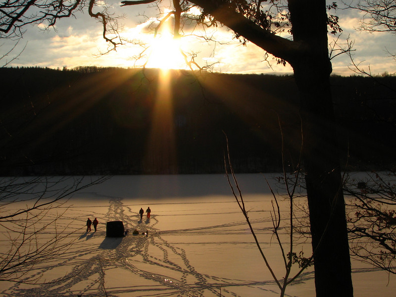 Ice fishermen at sunset, Canadice Lake NY.