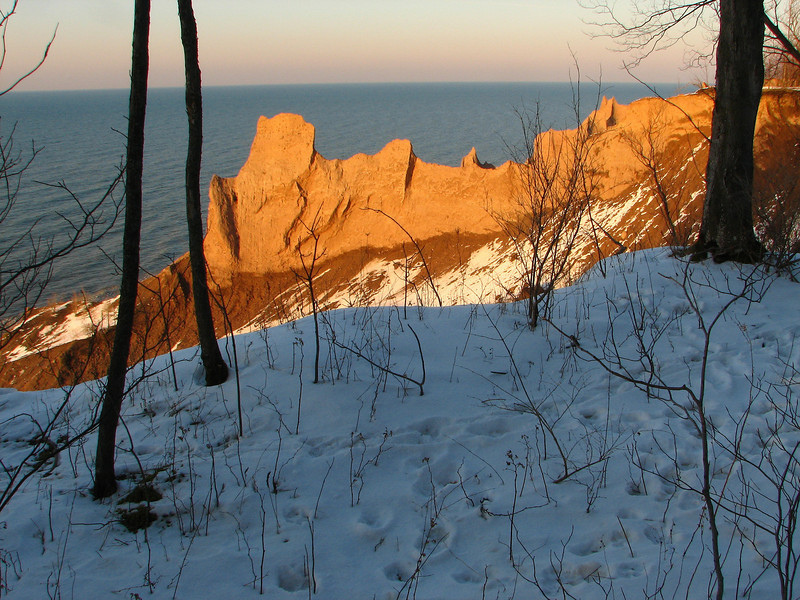 Sunset light glows on the cliffs of Chimney Bluffs NY.
