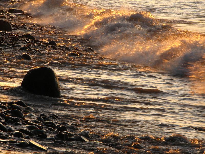 Surf at sunset, Lake Ontario at Chimney Bluffs NY.
