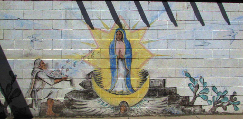 "Mural #3 - Miracle at Tepeyac<br /> <br /> Antonito Colorado, by Fred Haberlein<br /> <br /> The Murals of Conejos County Driving Tour ... ""through some of the most beautiful pastoral landscapes in the Rocky Mountains. The murals engage in the ages old local tradition of story-telling depicting tales of settlement, folklore, faith, scenic beauty and everyday rural life""."