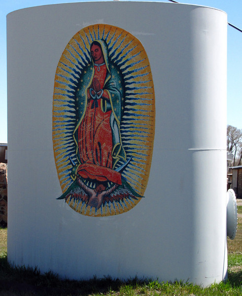 """Mural #17 - Our Lady of Guadalupe<br /> <br /> Village of Guadalupe Colorado, by Roger Briones<br /> <br /> The Murals of Conejos County Driving Tour ... """"through some of the most beautiful pastoral landscapes in the Rocky Mountains. The murals engage in the ages old local tradition of story-telling depicting tales of settlement, folklore, faith, scenic beauty and everyday rural life""""."""