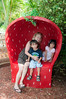 Family in Strawberry Seat