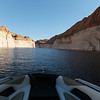 """In most of the photos, you'll notice a white line that is in all photos.  That line shows the """"full"""" mark of the lake behind the Glen Canyon Dam.  The current level is about 100' below the full line.  That gives you some idea of the height of the walls of the canyons.  I suggest you get on Google Earth and check out Lake Powell."""