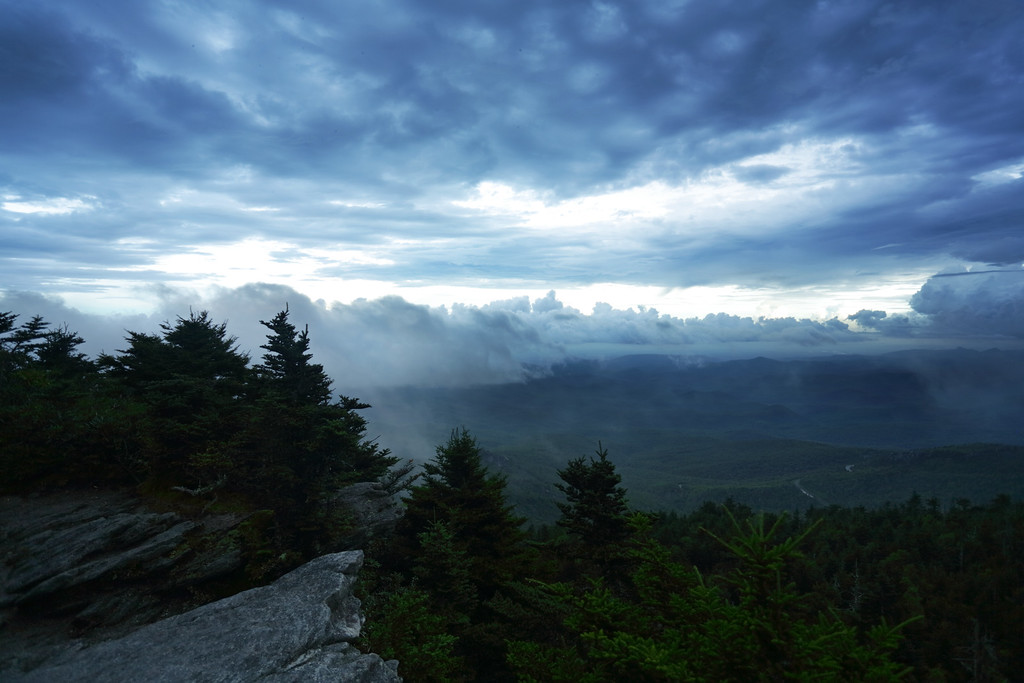 While filming the trails of Grandfather Mountain for the State Rangers, I finally made it to the top of MacRae peak for the last time, and for the second time that day from the opposite side. The fog cleared up just enough for me to capture a view of the valley below. The trail footage will be used to provide a virtual tour for disabled individuals who would never see the park otherwise. I was disappointed by cloudy weather for several days. And being able to use this finally clear footage for the virtual tour was very moving.