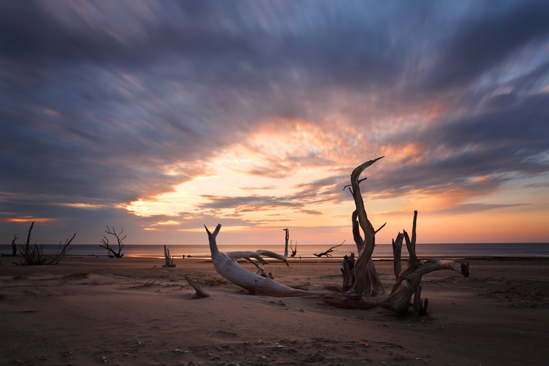 This photo was taken on the north eastern shore of Bull Island, South Carolina. A long exposure was used for cloud blur.