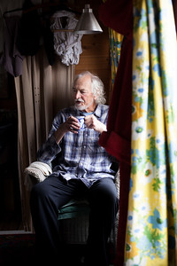 Pete O'Sullivan at home on 'Carolein'. Shoreham-By-Sea, Sussex, UK. April 2016.