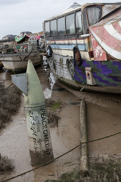 1.Low tide along the river reveals the 'peace one day' message inscribed by Hamish on a diffused artillery shell. Shoreham-By-Sea, Sussex, UK. April 2016.