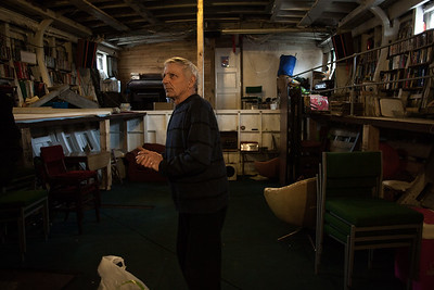 Fred in the living room and hull of 'Fische'. Shoreham-By-Sea, Sussex, UK. April 2016.
