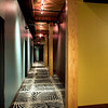 Guest floor corridors at The Iron Horse Hotel, with zebra-patterned carpets in homage to big game hunter Teddy Roosevelt, president when the building was constructed in 1907.<br /> Photo by: Mark Heffron