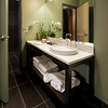 Custom Deluxe guest bathroom at The Iron Horse Hotel<br /> Photo by: Kenton Robertson
